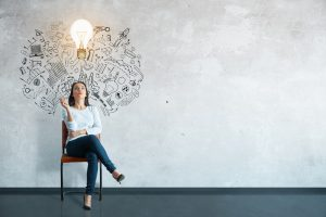 Woman thinking with lightbulb over head.
