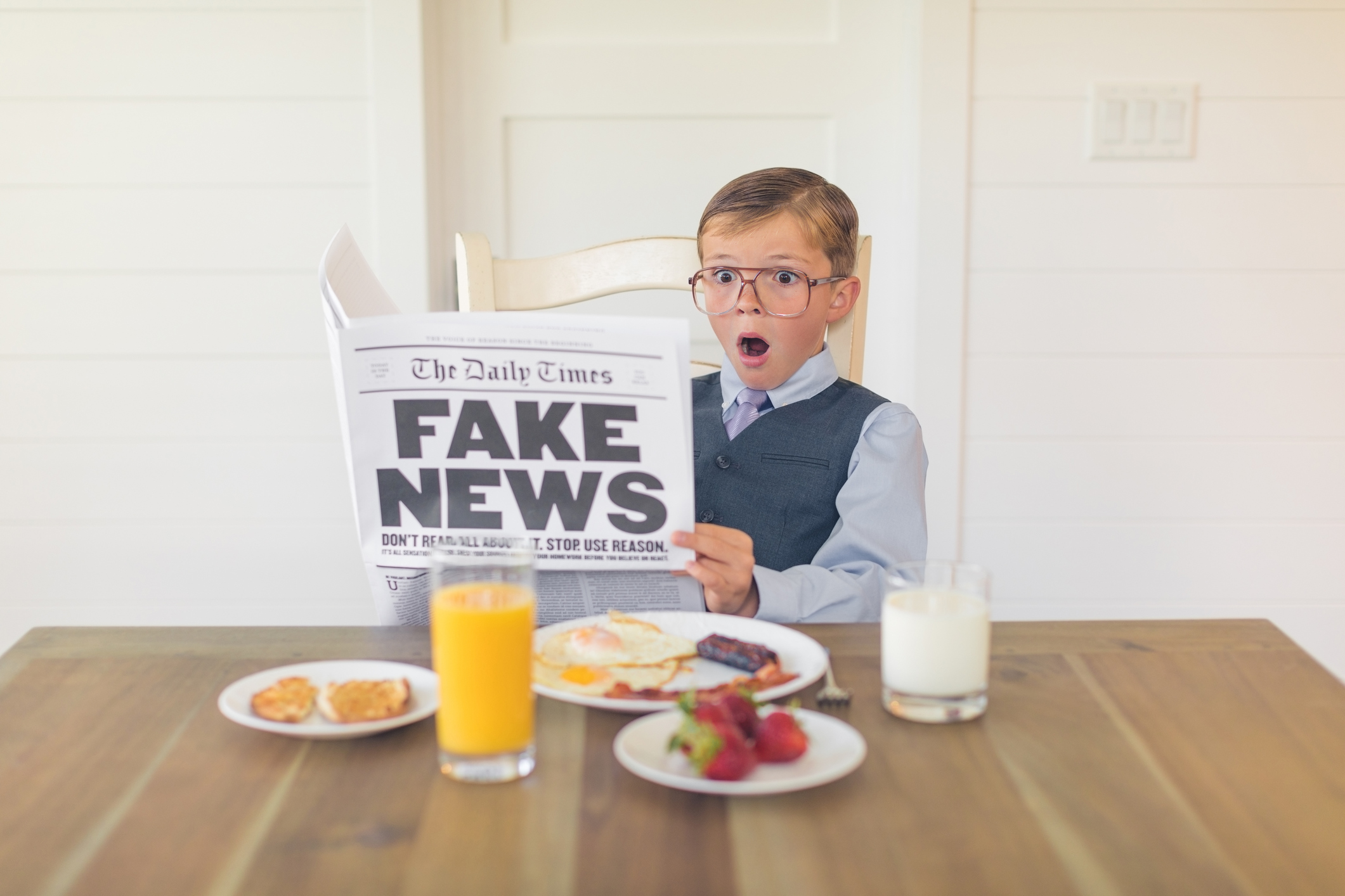 Young Businessman Reading Fake News is Shocked