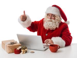 Santa Claus working with laptop