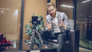 Businessman recording video for blog
